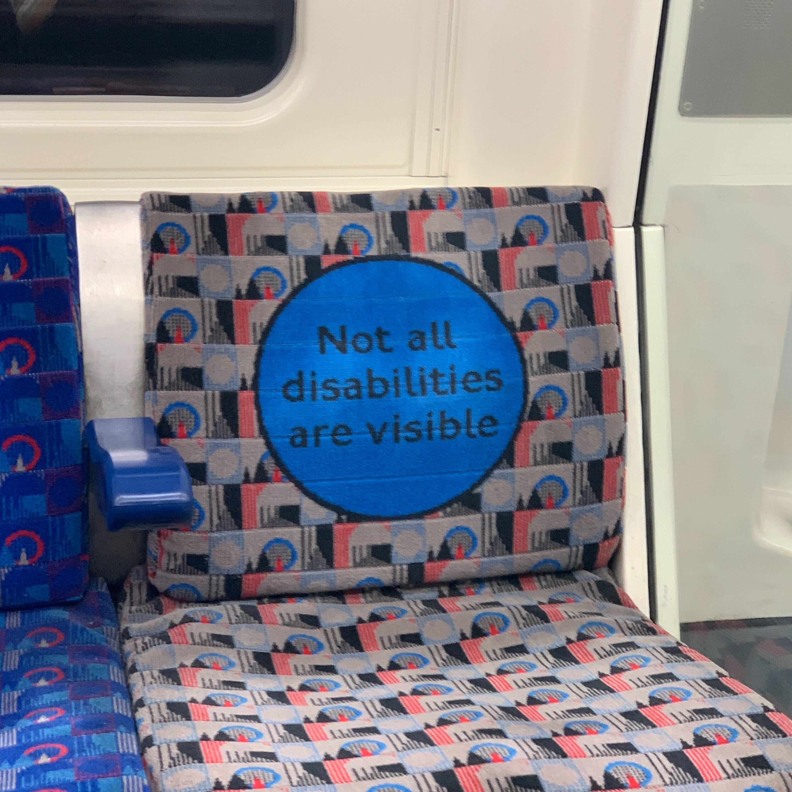A London Underground seat with the words: not all disabilities are visible