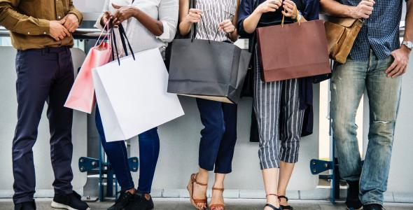 Group of millennials with shopping bags