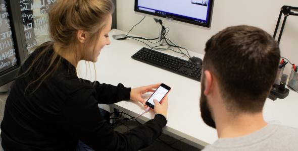 Blonde lady user testing an app on a phone